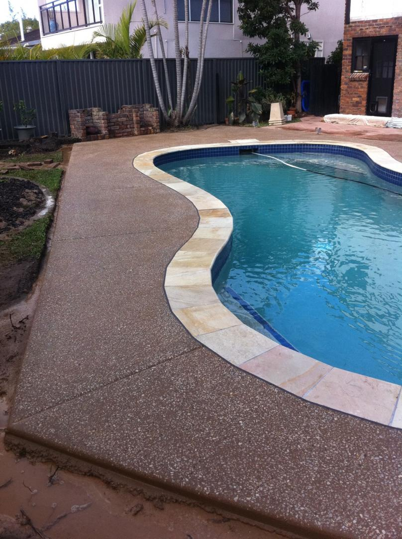 Pool surrounds city link concrete construction for Swimming pool surrounds design